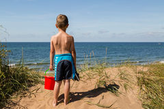 Boy with beach toys Royalty Free Stock Images