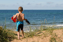 Boy with beach toys Royalty Free Stock Image