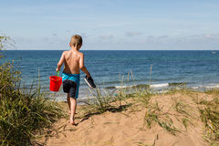 Boy with beach toys Stock Photography