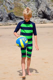 Boy on beach with volleyball Royalty Free Stock Image