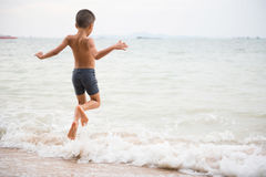 Boy on the beach Royalty Free Stock Images