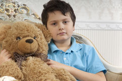 Boy with a bear Stock Photos