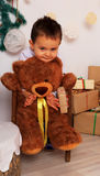 Boy and bear. A boy and a bear in a Christmas setting Royalty Free Stock Images