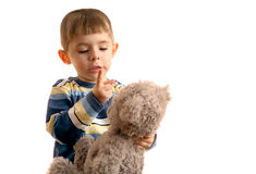 Boy with bear cub Royalty Free Stock Image