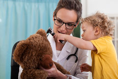 Boy with bear at pediatrician's office Stock Photos