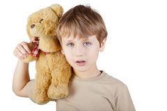 Boy with bear-toy sitting on his shoulder. Royalty Free Stock Photography
