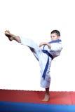 Boy beats a kick leg forward Royalty Free Stock Images