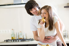 Boy and beautiful girl with pear Stock Photos