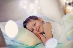 Boy in bed Stock Image
