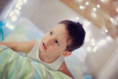 Boy in bed Royalty Free Stock Images