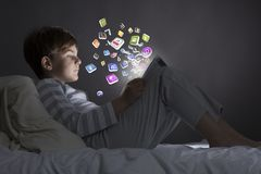 Boy in bed Royalty Free Stock Image