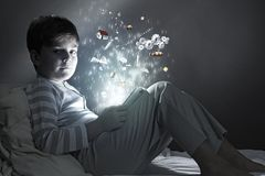 Boy in bed Stock Photo
