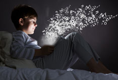 Boy in bed Royalty Free Stock Photography