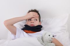 The boy in bed, his head hurts Stock Photography