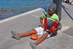 Boy begging. Playing accordion, Rhodes, Greece Royalty Free Stock Photography