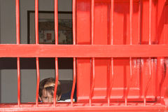 Boy behind bars Royalty Free Stock Photo