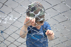 Boy behind bars Stock Images