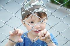 Boy behind bars Royalty Free Stock Image