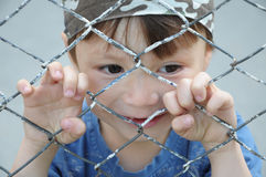 Boy behind bars Stock Photo
