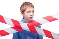 Boy behind cordon tape Royalty Free Stock Photography