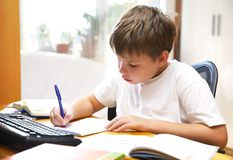 Boy behind a desk Stock Photos
