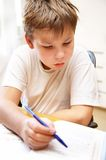 Boy behind a desk Royalty Free Stock Image