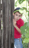 A boy behind the fence Royalty Free Stock Photo