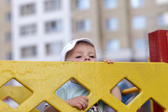 Boy behind fence Royalty Free Stock Photo