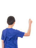 Boy from behind holding something. A teen boy in blue t-shirt with arm raised holding something unseen Stock Images