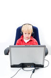 Boy behind a laptop Stock Photo