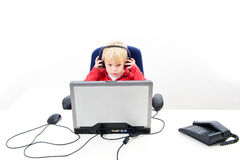 Boy behind a laptop Royalty Free Stock Images