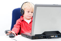 Boy behind a laptop Stock Photography