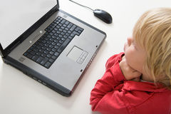 Boy behind laptop Royalty Free Stock Photos