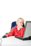 Boy behind laptop Royalty Free Stock Photography