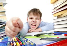 Boy behind a table with books Royalty Free Stock Photo