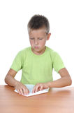 The boy behind a table over white Royalty Free Stock Photos