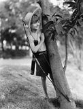 Boy behind tree with bow and arrow royalty free stock photos