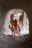 Boy behind tunnel Stock Photography