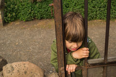 Boy behing the gates Royalty Free Stock Images