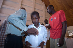 Boy Being Confirmed. September 30, 2008 - A young boy is confirmed at a Catholic ceremony in Gonaives, Haiti, weeks after Hurricane Ike hit the island, delaying Royalty Free Stock Image