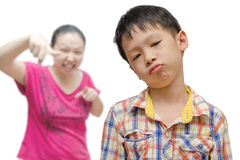 Boy Being Scolded by his mother Royalty Free Stock Images