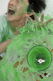 Boy being splashed by overflowing blender Royalty Free Stock Photography