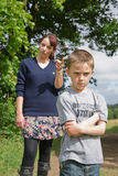 Boy being told off by his mum Stock Images