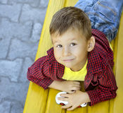 Boy on bench Royalty Free Stock Photo