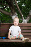 Boy on bench Stock Images