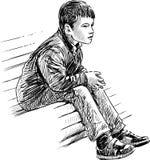 Boy on bench Stock Photo