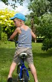 The boy with a bicycle Royalty Free Stock Image