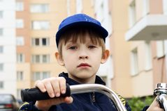 The boy with a bicycle Stock Photo