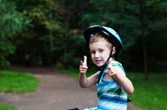 Boy on bicycle. Young smiling boy on bicycle Stock Image