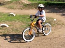 Boy on bicycle stock photo